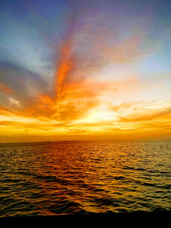 Looking out over the water from the Galveston Island Ferry at Sunset. Sunset in the Gulf of Mexico in Galveston, Texas. Peaceful, colorful sunset at dusk.
