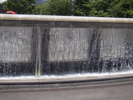 trickle down: Flow of cool likely water At a nearby Telecom Center Stock Photo