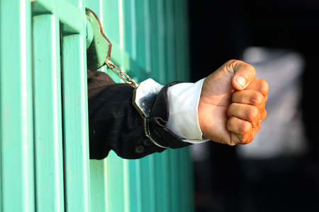 Prisoner in prison with handcuff