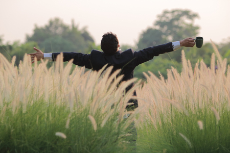 Happy business with reeds grass background