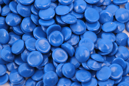 blue color chemistry plastic granulate in light for background  pellets material factory
