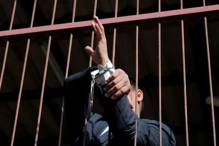 detained: Prisoner in prison with handcuff