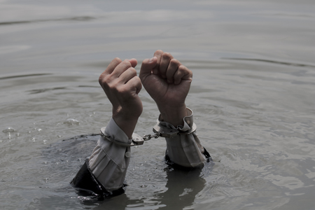 sink: Businessmen shackled handcuffs.