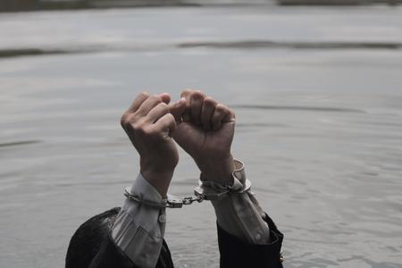 Businessmen shackled handcuffs.