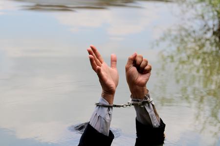 Businessman gets put his hands is drowning handful. Reklamní fotografie