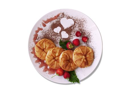 A delicious dish for Breakfast with pancakes, berries and cocoa powder with a heart