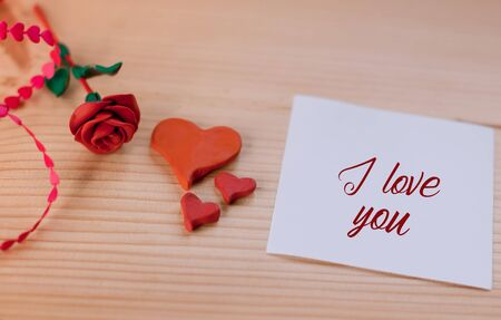 Beautiful message for a loved one with the inscription I love you with a heart and a rose of plasticine Imagens