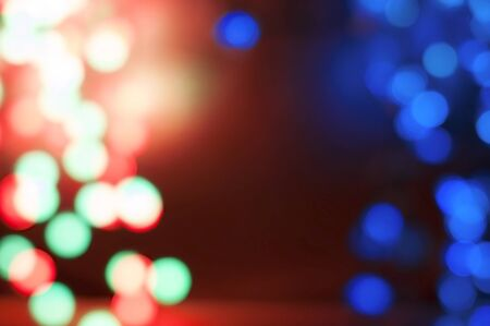 Beautiful blurred bokeh background with blue and purple and red circles for holiday and Christmas cards  Stock Photo