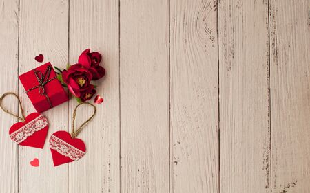 Holiday background for Valentines day on a white wooden   background in retro style with gifts.