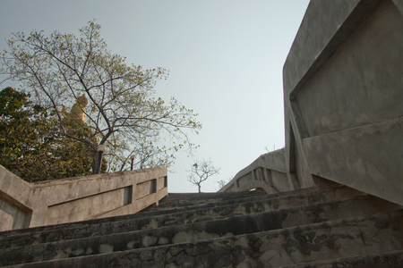 up stair: Steep stair up to Buddha on the top of mountain Stock Photo