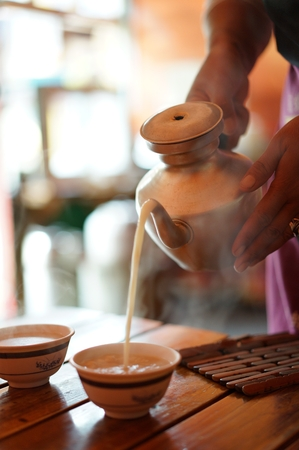 Butter tea in the ancient town of Moxi