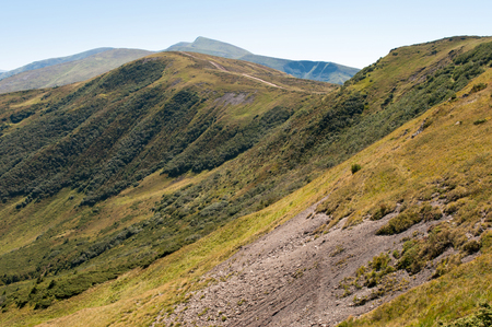 hillsides: Carpathian mountains in late summer. Ukraine. Steep hillsides of Svydovets ridge covered with stone Stock Photo