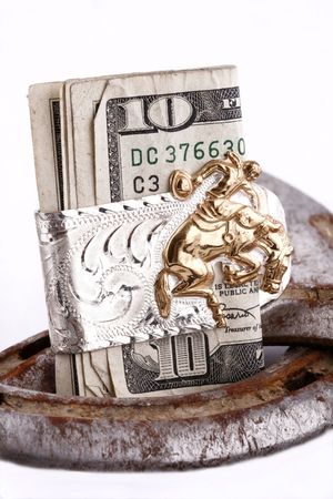 money in a bucking bronc money clip with horseshoes photo
