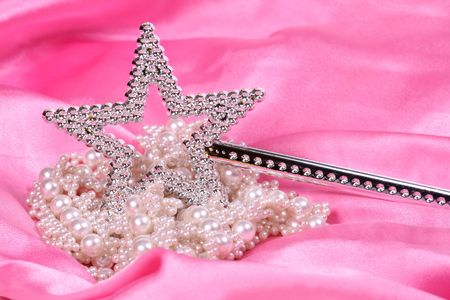 fake diamond: Magic wand with pearls on satin material