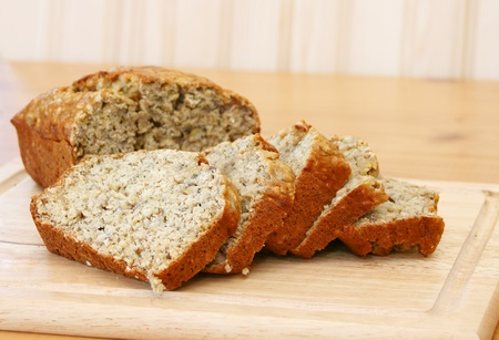 banana oatmeal bread with slices on a wooden cutting board photo