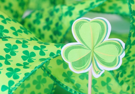 paper shamrock decoration with shamrock ribbon in the background for St. Patrick's Day Stock Photo - 9039728