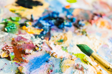 Art brush and palette with oil paints. Soft focus. Фото со стока