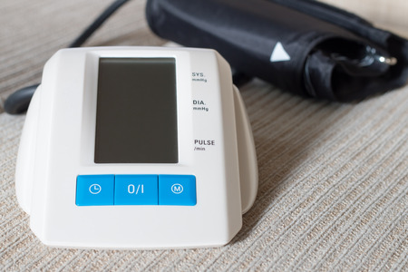 Digital blood pressure on table in a home photo