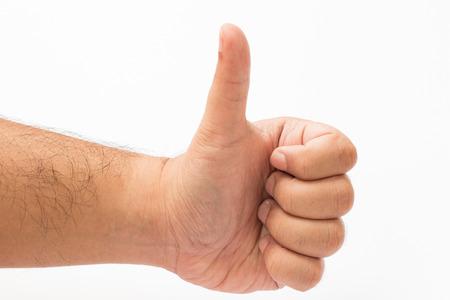 tumb: Tumbs up hand sign on white background.