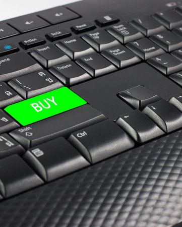 Green buy button on keyboard,Businees concept.
