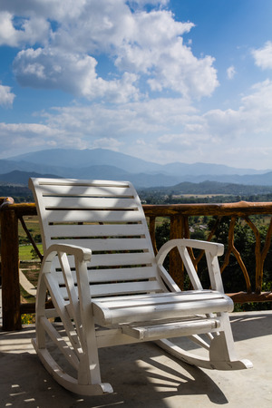 alfresco: White wooden chair on the terrace in a bright holiday.