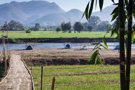 campsite: bamboo bridge and campsite near the river