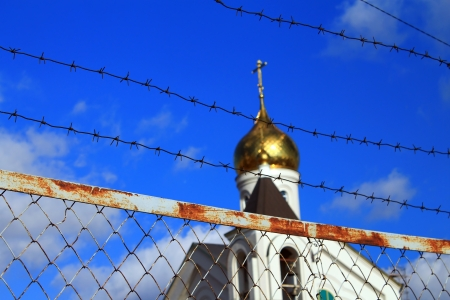 leeway: The Church behind the barbed wire  Religion banned Stock Photo
