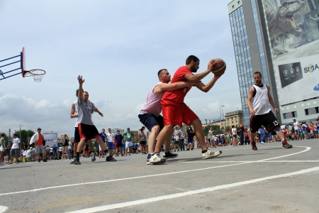 VOLGOGRAD, RUSSIA - MAY 26: Young people play in streetball on the open area located next to the \'dancing\' bridge. Annual streetball party organized Europa city Mall, on may 26, 2013 in Volgograd