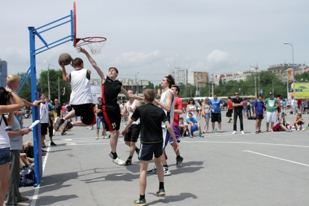 dank: VOLGOGRAD, RUSSIA - MAY 26: Young people play in streetball on the open area located next to the dancing bridge. Annual streetball party organized Europa city Mall, on may 26, 2013 in Volgograd