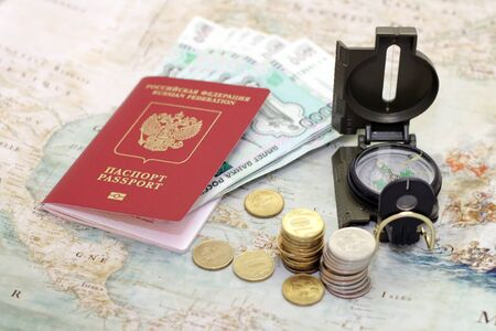routing: Passport, money and compass lie on the background of the map of the world Stock Photo