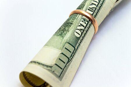 Dollar in wedding ring photo