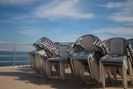 bowel movement: The chairs are stacked in piles  Open-air restaurant