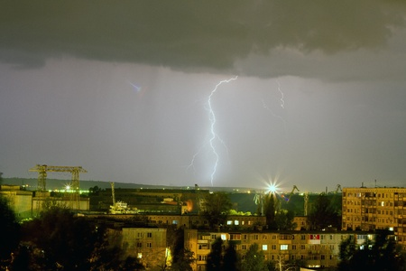 Storm over the city  Lightning flashed photo