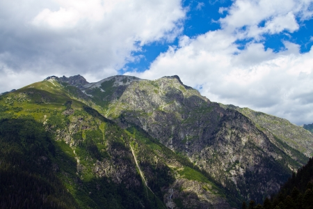 dombai: Mountain peaks in Dombai  Summer in cloudy weather Stock Photo