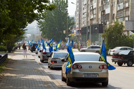 a faction: Pre-election campaign 2013  The column of cars with flags of the liberal democratic party travels to the city and agitate citizens Editorial