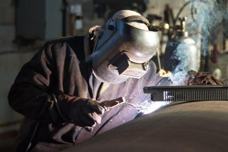 Welder working on welding of shells heat exchanger