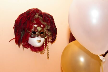 mask and balloon on the wall photo