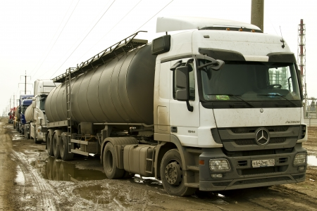 Tank trucks are waiting to fill bitumen near the refinery