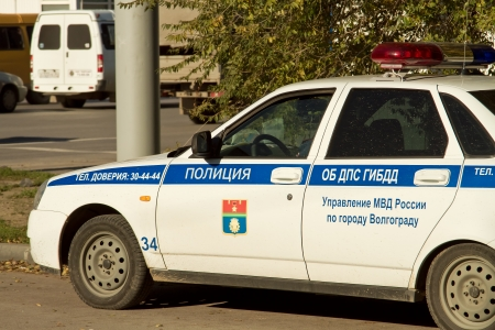 patrolling:  VOLGOGRAD - OCTOBER 23 A police car patrolling the streets of the city after the attack, 21 October  October 23, 2013 in Volgograd, Russia