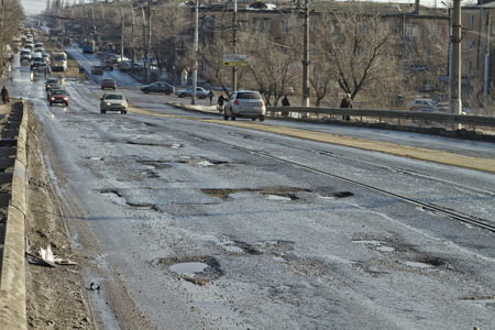 pits: VOLGOGRAD - FEBRUARY 22  Terrible pavement or the lifting bridge  All asphalt in the pits  February 22, 2014 in Volgograd, Russia