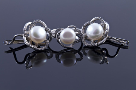 reflectivity: Silver earrings with pearls Stock Photo