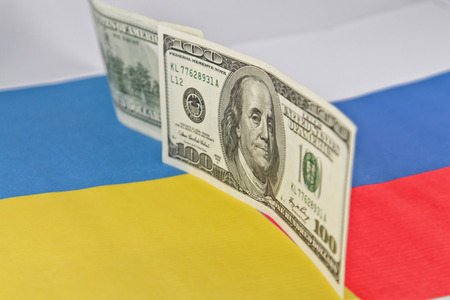 the borderline: border between Russia and Ukraine in the form of banknotes of 100 dollars