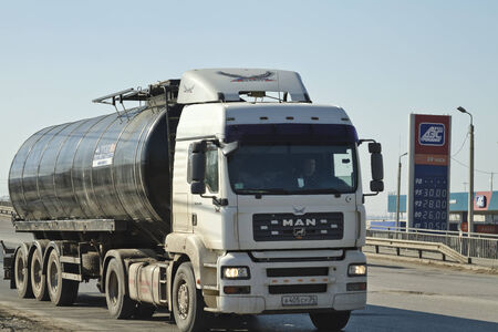 refills: VOLGOGRAD - MARCH 15  Tank-truck is driving around the city by fuel refills  March 15, 2014 in Volgograd, Russia  Trucks destroy the pavement in the city Editorial