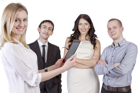 bussines people: Beautiful girl with tablet in hand on the background colleagues from office