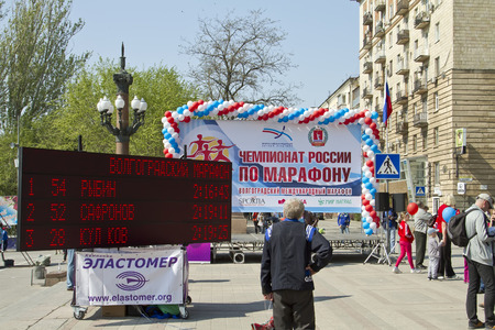 VOLGOGRAD - MAY 4  Results of Volgograd marathon recorded on the electronic scoreboard, standing near the stage with symbols of the Russian championship of marathon  May 4, 2014 in Volgograd, Russia