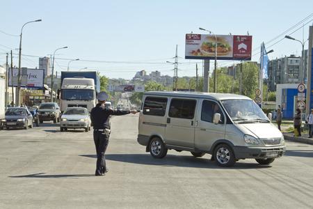 volgograd: VOLGOGRAD - MAY 7  Police road service regulate traffic with a rod  May 7, 2014 in Volgograd, Russia