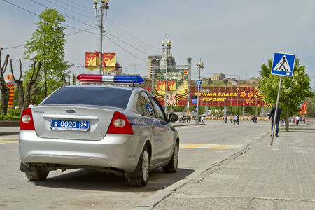 VOLGOGRAD - MAY 9  New police car is standing in the cordon at the victory parade  May 9, 2014 in Volgograd, Russia  Editorial