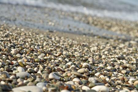 landfall: Small pebbles and waves