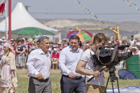 bureaucrat: SMALL CHAPURNIKI, VOLGOGRAD, RUSSIA - MAY 24  Mayor of Volgograd Andrei Bocharov and the President of  Tatarstan Rustam Minnikhanov at festival Rural Sabantui-2014  May 24, 2014 in Volgograd, Russia