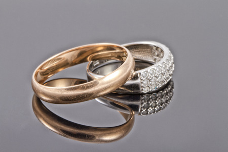reflectivity: Gold and silver wedding rings Stock Photo